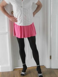 husband in pink skirt